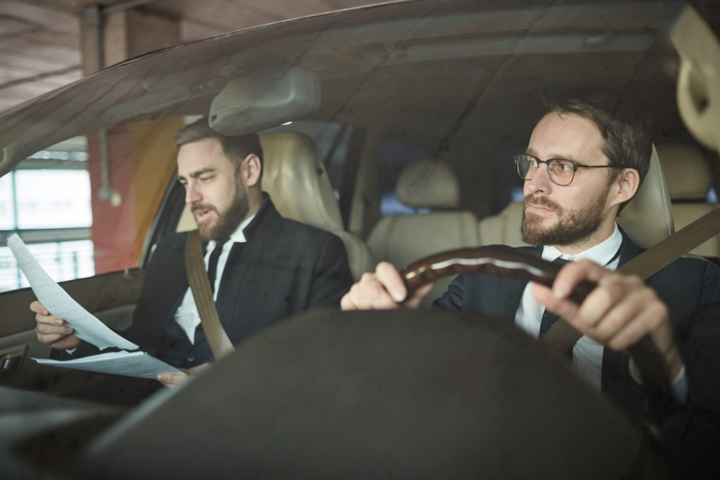 Businessman and his driver in the car